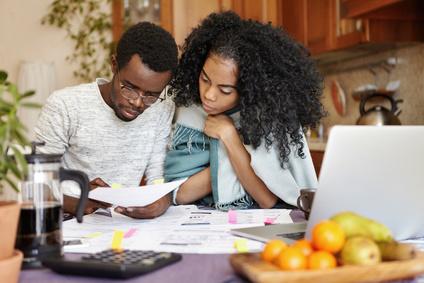 Couple paying debts
